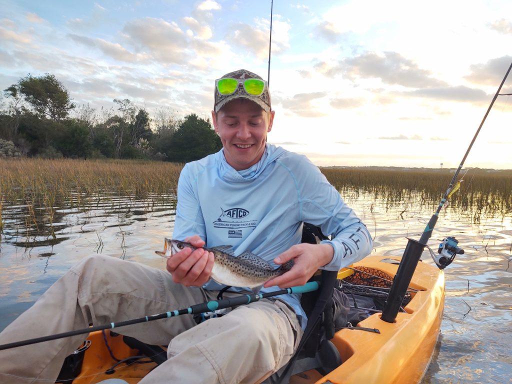 Kayak angler with sea trout