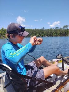 kayak angler with bass